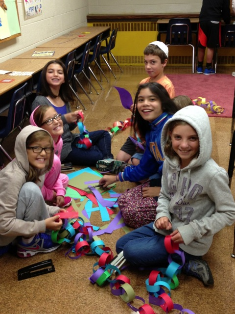 Hebrew School Making Chains for Sukkah Decorations